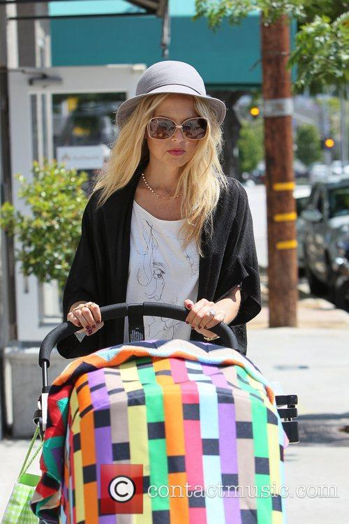Rachel Zoe pushes a baby carriage (son Skyler...