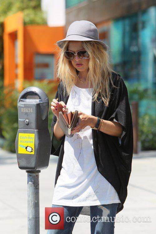 Rachel Zoe  feeds a parking meter in...