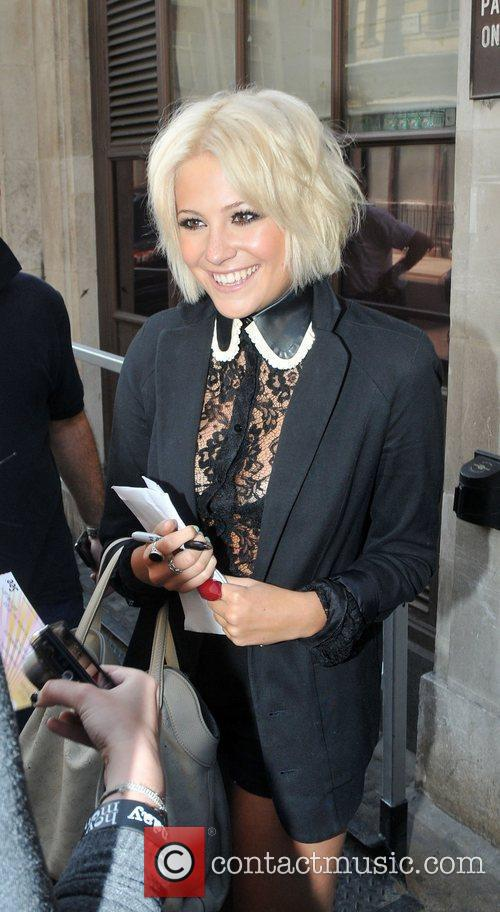 Shows off her new shorter hair style as...