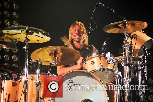 Taylor Hawkins Foo Fighters perform during BBC Radio...