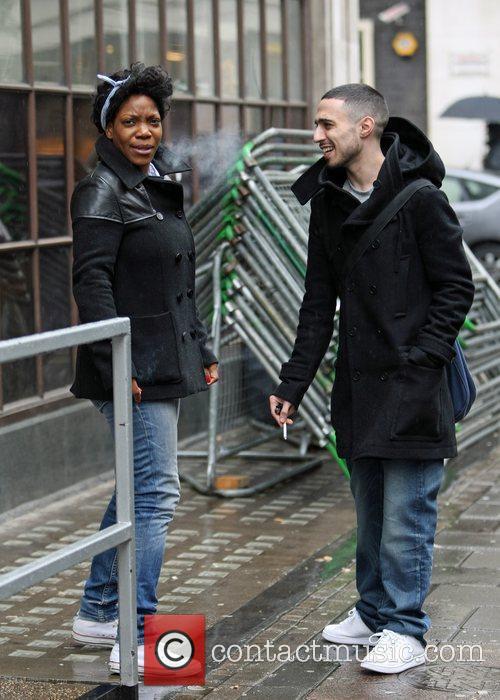 As he smokes a cigarette outside the BBC...