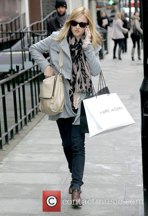 Fearne Cotton talking on her mobile phone outside...