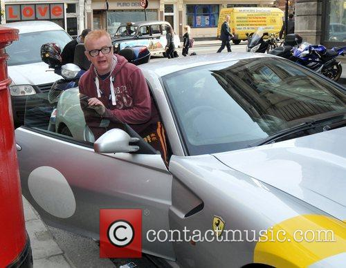 Chris Evans gets into his Ferrari...