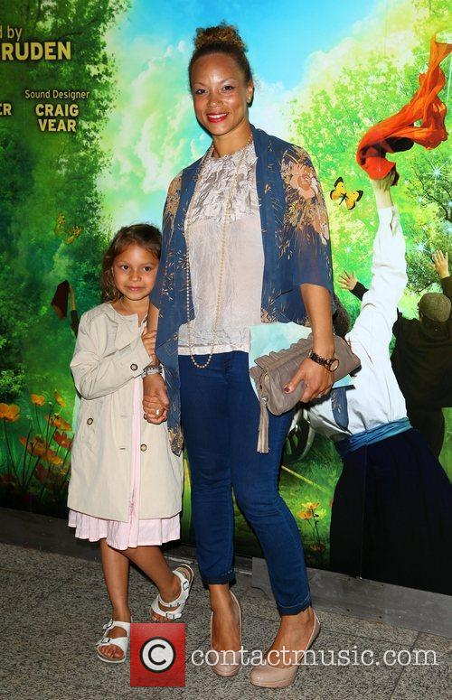 Angela Griffin and daughter arriving at the opening...