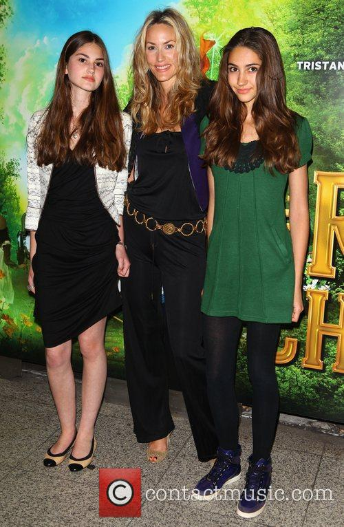 Lisa Butcher (C.) and daughters Olivia Donoso and...