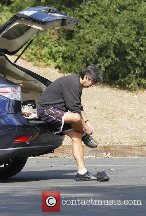 ray romano changing into his walking shoes 3568693