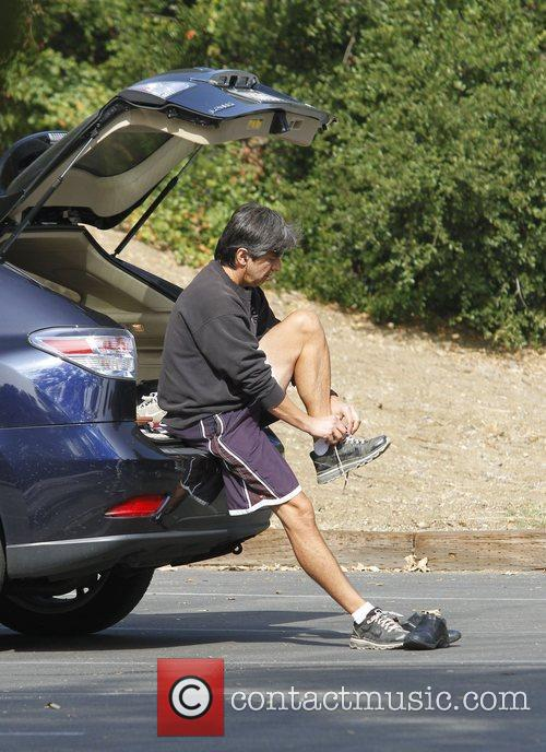 ray romano changing into his walking shoes 3568701