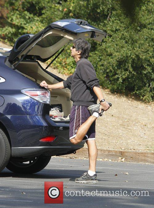 ray romano stretching before taking a hike 3568697