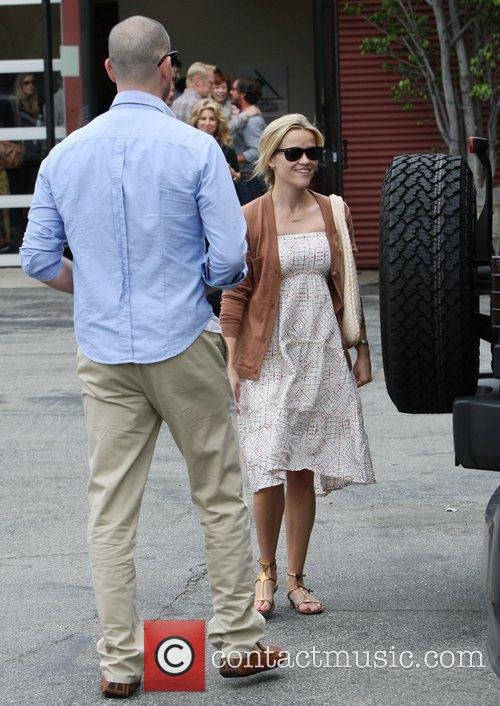 Jim Toth and Reece Witherspoon leaving church in...