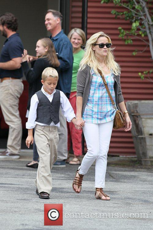 Reese Witherspoon, her son Deacon Phillippe and husband...