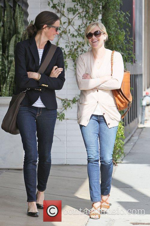 Reese Witherspoon and a friend leave Comme Ca...