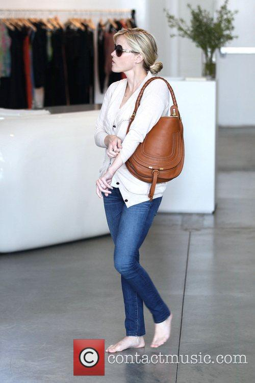 Reese Witherspoon  shopping with a friend at...