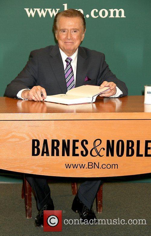 Regis Philbin signs his new book 'How I...