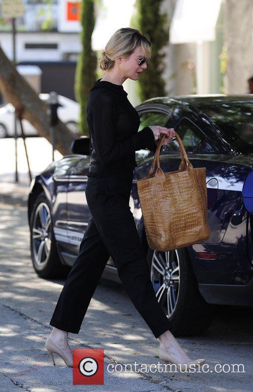 Renee Zellweger is seen using her Blackberry after...
