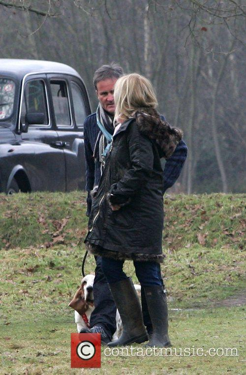 And his wife Julia taking their dogs for...