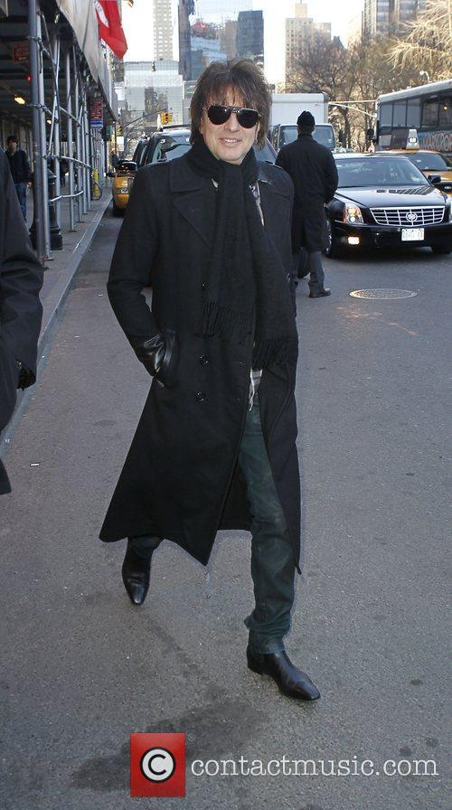 Leaving his hotel in New York City