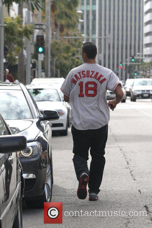 Running to his car in Beverly Hills