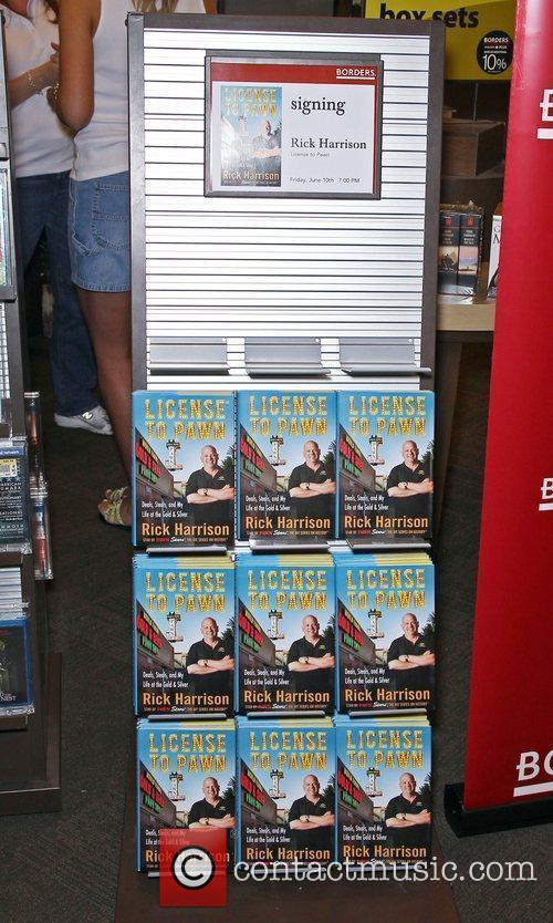 Rick Harrison of Pawn Stars signs copies of...