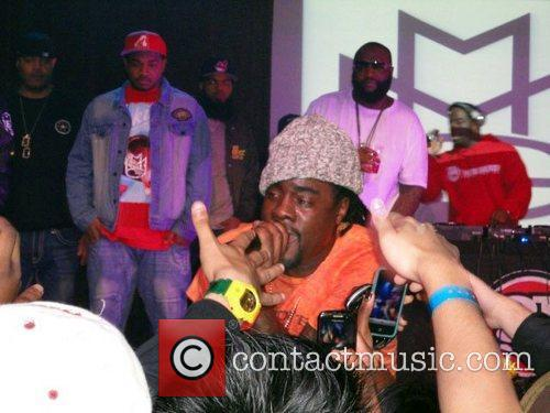 Rick Ross appears onstage to support his rap...