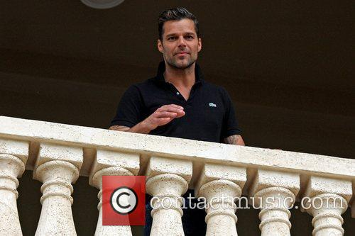 Ricky Martin posing on a balcony during at...