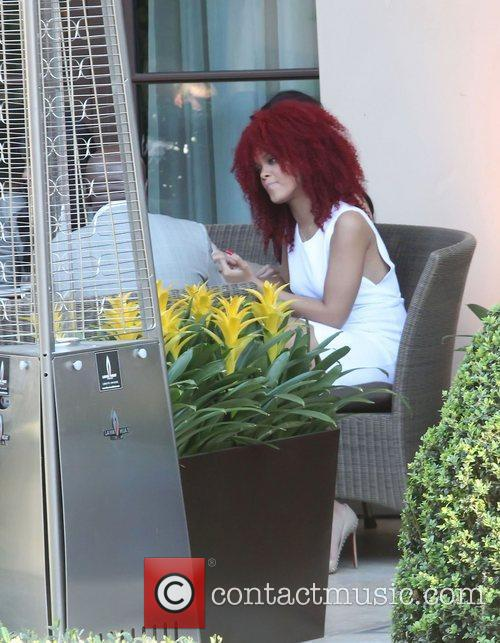 Rihanna sits outside the front of the Montage...
