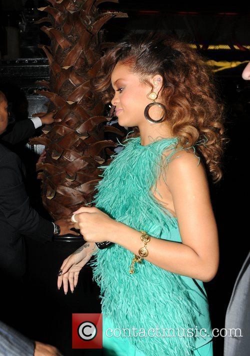 Rihanna  returning to her hotel after leaving...