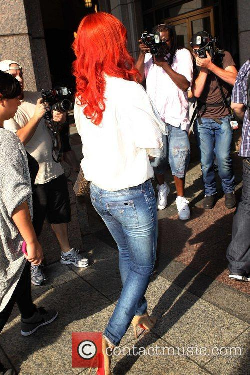 Rihanna making her way through the crowd of...