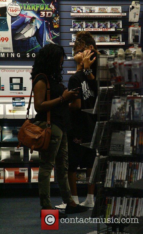 Rihanna and her younger brother Rajad shopping at...