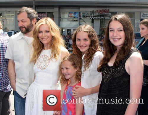 Judd Apatow and Leslie Mann with their daughters...