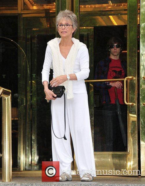 Rita Moreno dressed in white leaves her midtown...