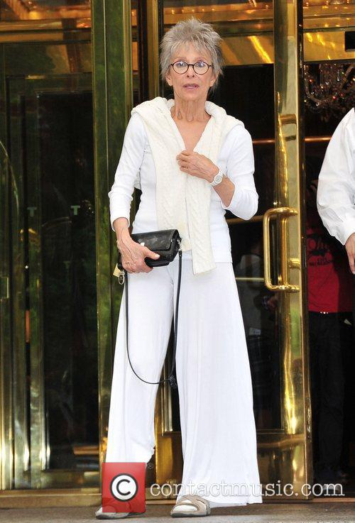 Rita Moreno dressed in white leaves her midtown...