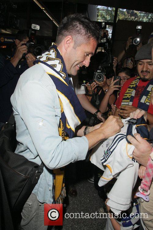 Robbie Keane meeting a large group of fans...
