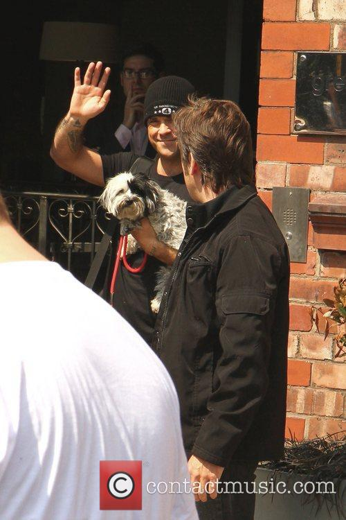 Robbie Williams, his wife and their small dog...