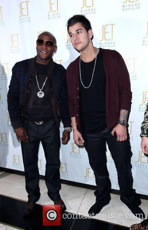 Floyd Mayweather and Robert Kardashian Robert Kardashian celebrates...