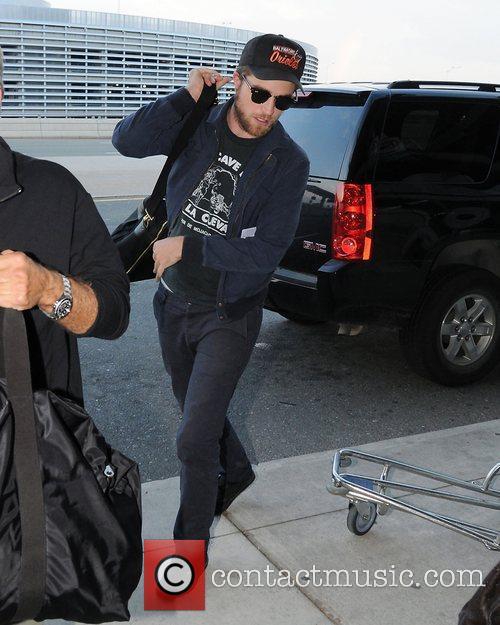 Robert Pattinson departs from Toronto's Pearson International Airport....