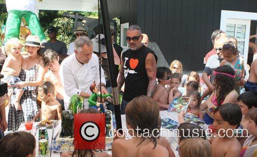 Christian Audigier  Christian Audigier's son Rocco celebrates...