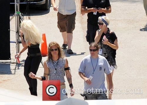 Shane Hartline and cast members on set during...