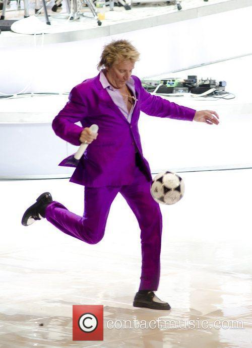 Rod Stewart kicking a soccer ball Rod Stewart...