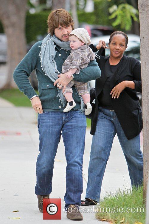 Rodger Berman holds his son Skyler as he...