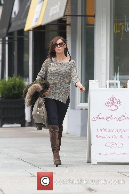 Rose McGowan leaving a salon wearing sunglasses, knee...