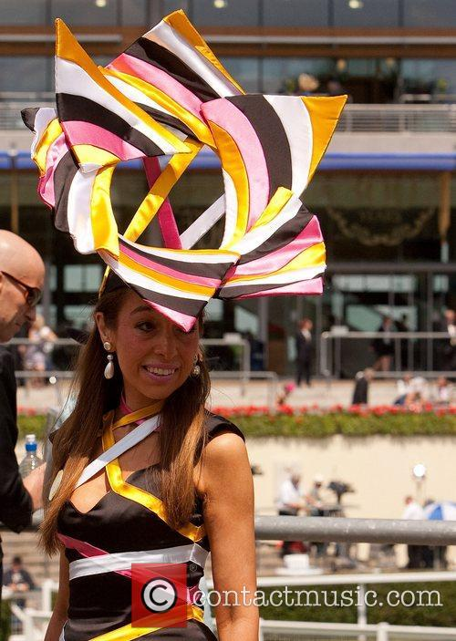 Atmosphere A women showing off her hat at...