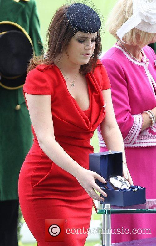 Princess Eugenie presents trophies to the winner's trainer...