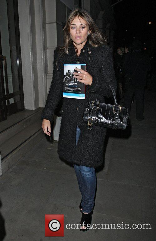 Liz Hurley leaving the Royal Opera House after...