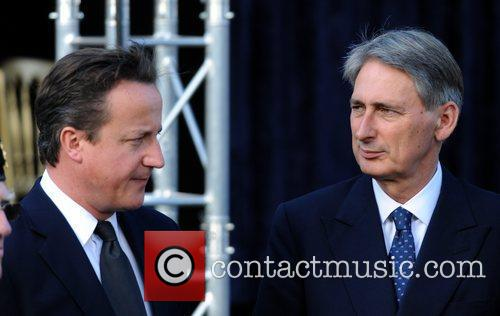 Prime Minister David Cameron and the new Secretary...