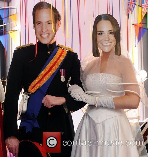 Masked royal look-a-likes pose for a photocall at...