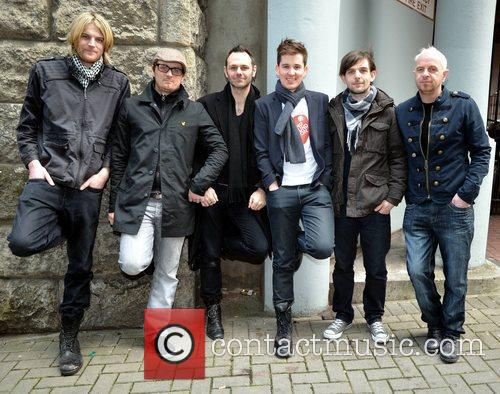 Alternative rock band Royseven  poses outside Today...