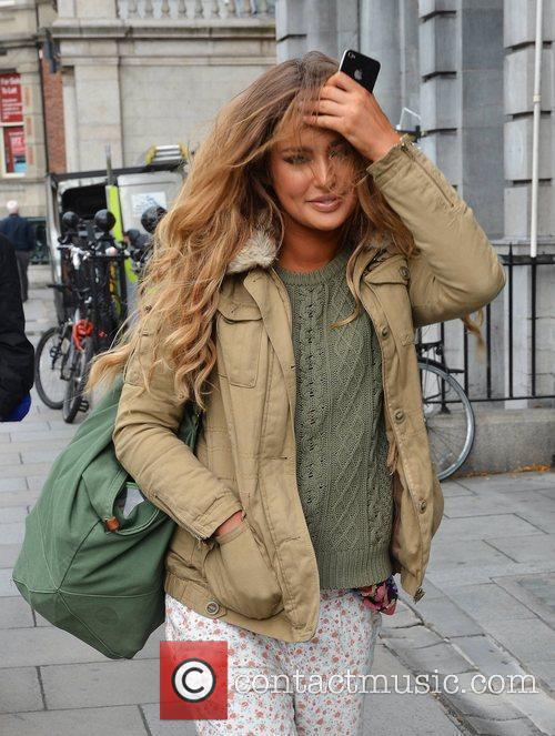 Spotted wearing pyjama bottoms, former Miss Universe Ireland...