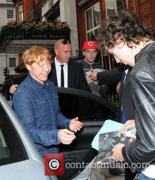 Harry Potter star, Rupert Grint, signs autographs outside...