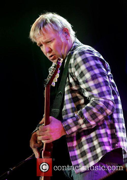 Alex Lifeson of Rush performing on stage their...
