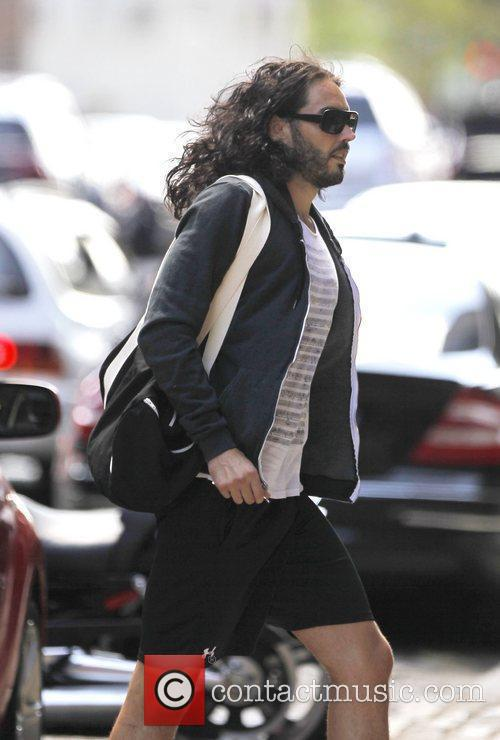 Russell Brand is seen riding a bicycle in...
